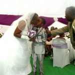 Proof rumours that Sanele required a step-ladder to kiss the bride are utterly untrue