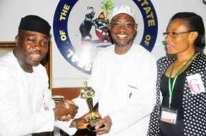 President of the Links International, Mr. Niyi Dada, Governor, State of Osun, Ogbeni Rauf Aregbesola and Public Relations Officer of the Houston African Community International, Mrs Janet Olusola in a dramatic presentation of an award of Rise and Shine African Outstanding Leadership in Houston Texas to the Governor during a courtesy visit at the State Government House, Osogbo